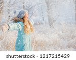 child walking at winter park.... | Shutterstock . vector #1217215429