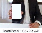 businessman holding smartphone... | Shutterstock . vector #1217215960