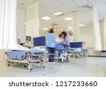 busy emergency room with wheel... | Shutterstock . vector #1217233660
