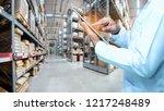 warehouse worker or supervisor... | Shutterstock . vector #1217248489
