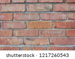 red wall from big stone... | Shutterstock . vector #1217260543