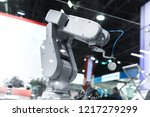 automatic robot arm working in... | Shutterstock . vector #1217279299