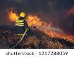 firefighters battle a wildfire | Shutterstock . vector #1217288059