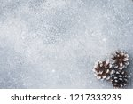 pine cones on a gray background ... | Shutterstock . vector #1217333239
