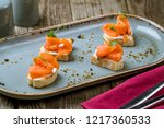 bruschetta with salmon and... | Shutterstock . vector #1217360533