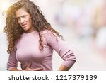 beautiful brunette curly hair... | Shutterstock . vector #1217379139