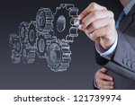 businessman hand draws gear to... | Shutterstock . vector #121739974