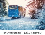 bus on winter road through... | Shutterstock . vector #1217458960