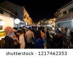 people visit the shops along... | Shutterstock . vector #1217462353