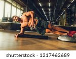 sportsman training at the gym... | Shutterstock . vector #1217462689