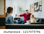 nurse walking a patient down... | Shutterstock . vector #1217475796