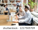 diverse millennial colleagues... | Shutterstock . vector #1217505709