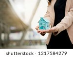 Small photo of Blue house is on hand. Home buying Renovation of home to find loan with good interest. In order to be able to repay the debt without a problem in financial institutions. Location is important to buy.