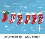 christmas socks hanging on rope ... | Shutterstock .eps vector #121759894