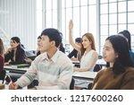 business woman raising hand for ... | Shutterstock . vector #1217600260