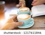 hand women and man put a latte... | Shutterstock . vector #1217611846