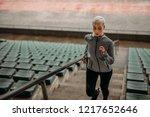female athlete running up the... | Shutterstock . vector #1217652646