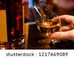 man tasting single malt whiskey ... | Shutterstock . vector #1217669089