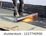 waterproofing flat roof with... | Shutterstock . vector #1217740900