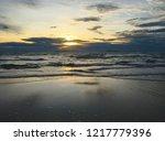 sunset island water waves sky | Shutterstock . vector #1217779396