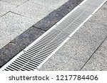Metal Gutter On A Pedestrian...