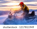 A Man Is Riding Snowmobile In...
