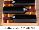 Three Red Wine Bottles In A...