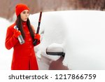 female driver with snow brush... | Shutterstock . vector #1217866759