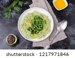 mashed potatoes with green peas ... | Shutterstock . vector #1217971846