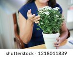 crop shot of woman at table... | Shutterstock . vector #1218011839