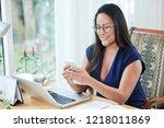cheerful adult thai... | Shutterstock . vector #1218011869