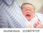 baby crying in mother embrace.... | Shutterstock . vector #1218074719