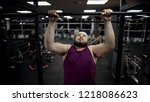 chubby man pulling up on bar ... | Shutterstock . vector #1218086623