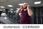 fat man putting on headset and... | Shutterstock . vector #1218086683