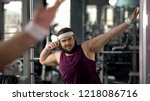 trendy fat man showing dab move ... | Shutterstock . vector #1218086716
