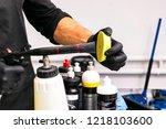 car polish wax worker hands... | Shutterstock . vector #1218103600