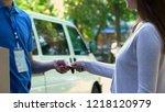 courier receiving cash payment... | Shutterstock . vector #1218120979