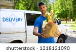 delivery company worker holding ... | Shutterstock . vector #1218121090