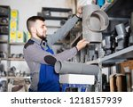 young worker  examining a... | Shutterstock . vector #1218157939
