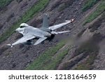 military jet fighter flying... | Shutterstock . vector #1218164659
