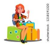 happy girl sitting on pile of... | Shutterstock .eps vector #1218191320