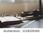 gold eyes glasses on open book... | Shutterstock . vector #1218220183