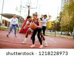 group of multiracial young... | Shutterstock . vector #1218228973