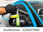 car polish wax worker hands... | Shutterstock . vector #1218257800