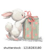 Stock photo cute birthday cartoon hare with present box 1218283180