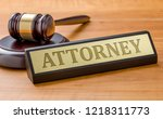a gavel and a name plate with... | Shutterstock . vector #1218311773