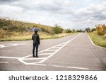 young man with umbrella...   Shutterstock . vector #1218329866