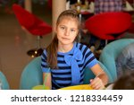a teenage girl in a striped... | Shutterstock . vector #1218334459