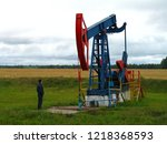 a blue with red oil rig pumps...   Shutterstock . vector #1218368593
