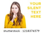 Small photo of irritated shirty librarian shows you her index finger as she wants you to be silent. or is this the mom gesturing to her children?